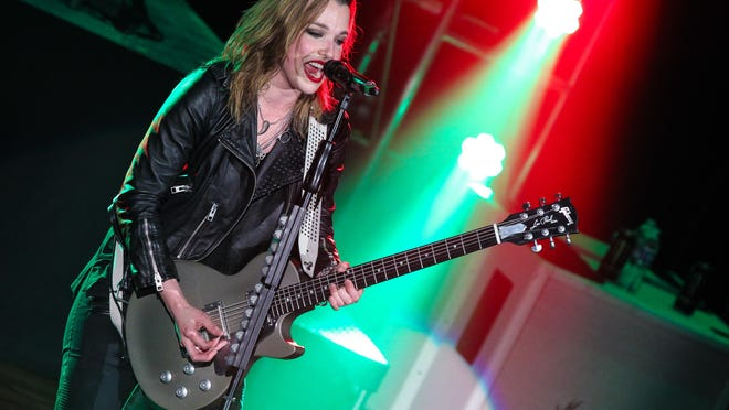 NASHVILLE, TN - APRIL 22: Singer and guitarist Lzzy Hale of Halestorm performs at the Ryman Auditorium on April 22, 2015 in Nashville, Tennessee. (Photo by Terry Wyatt/Getty Images)