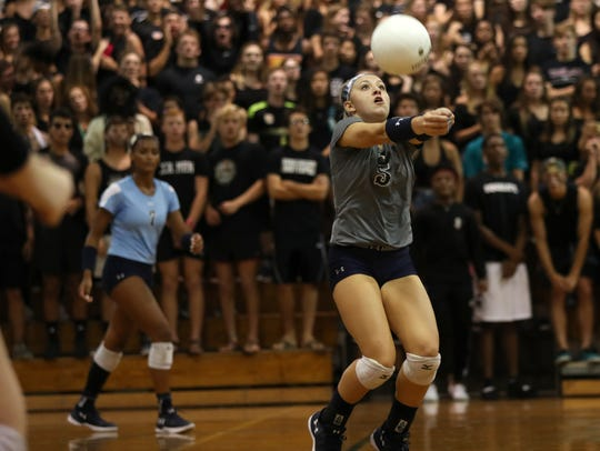 Maclay's Addyson Lewis sets the ball against Chiles