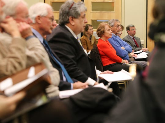 Members of the public attend a forum Monday at the