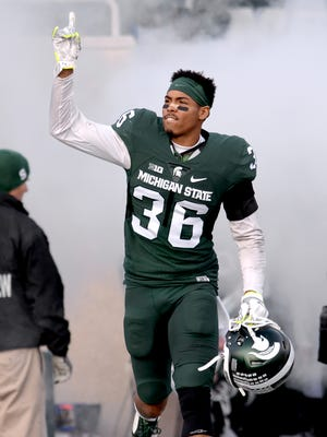 Arjen Colquhoun (36) runs out onto the field during Senior Day festivities before MSU's 55-16 win over Penn State Saturday, November 28, 2015, at Spartan Stadium in East Lansing.