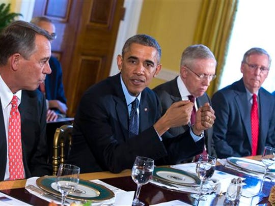 In this Nov. 7, 2014 file photo, President Barack Obama meets with Congressional leaders in the Old Family Dining Room of the White House in Washington. From left are, House Speaker John Boehner of Ohio, Obama, Senate Majority Leader Harry Reid of Nev., and Senate Minority Leader Mitch McConnell of Ky. (AP Photo/Evan Vucci, File)