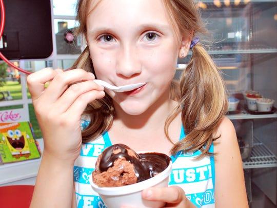 Alyssa Debiasio of Flemington enjoys an ice cream sundae at Thee Ice Cream Parlor at Turntable Junction in Flemington.