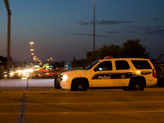 A Phoenix police vehicle cruises by an I-17 overpass