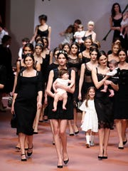 Models wear creations for Dolce & Gabbana women's Fall-Winter
