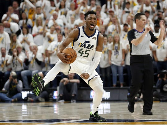 Utah Jazz guard Donovan Mitchell (45) reacts late in the second half during Game 4 of a first-round NBA basketball playoff series against the Houston Rockets, Monday, April 22, 2019, in Salt Lake City. (AP Photo/Rick Bowmer)
