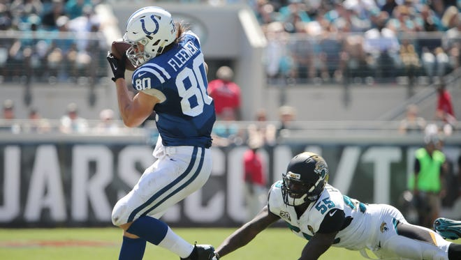 Indianapolis Colts TE Coby Fleener pulls in a 23-yard pass in the second quarter in front of Jacksonville Jaguars LB Geno Hayes.