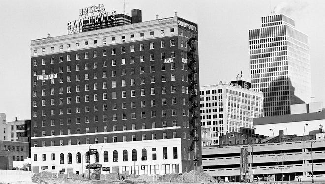Officials of the Levy Wrecking Co. are making last minute prep work before bring down the historic Sam Davis Hotel with 200 pounds of dynamite Feb. 16, 1985.