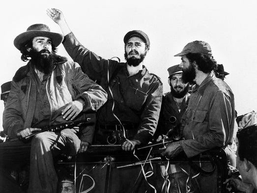 Cuban rebel leader Fidel Castro is surrounded by members