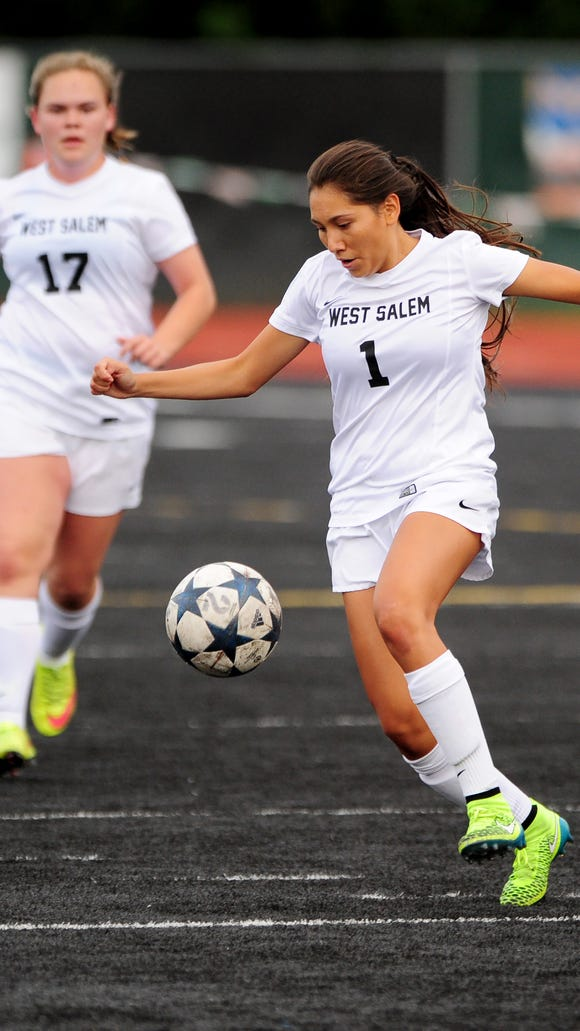 West Salem midfielder Liz Mendez controls the ball against McKay during a Greater Valley Conference game, Friday, October 23, 2015, at West Salem High School in Salem, Ore.