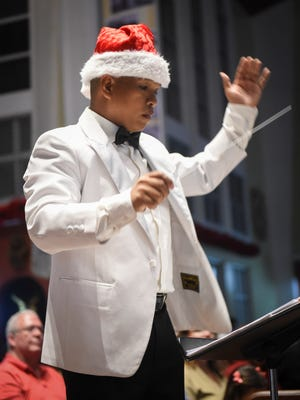 Maximo Ronquillo, Jr., chief band master of the Guam Territorial Band, performs Christmas at the Cathedral at the Dulce Nombre De Maria Cathedral-Basilica in Hagåtña on Dec. 21, 2016.