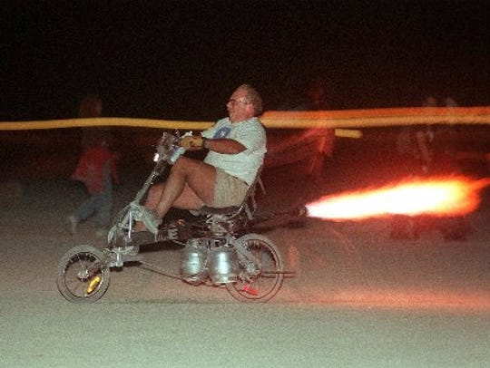 A flame-throwing bicycle at the 1996 Burning Man Festival.