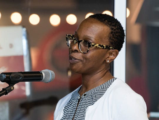 """Shakita Jones speaks during the unveiling of the """"Colored"""""""