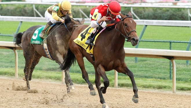 Cristina's Journey, right, with jockey Miguel Mena, won the Pocahontas in September at Churchill Downs