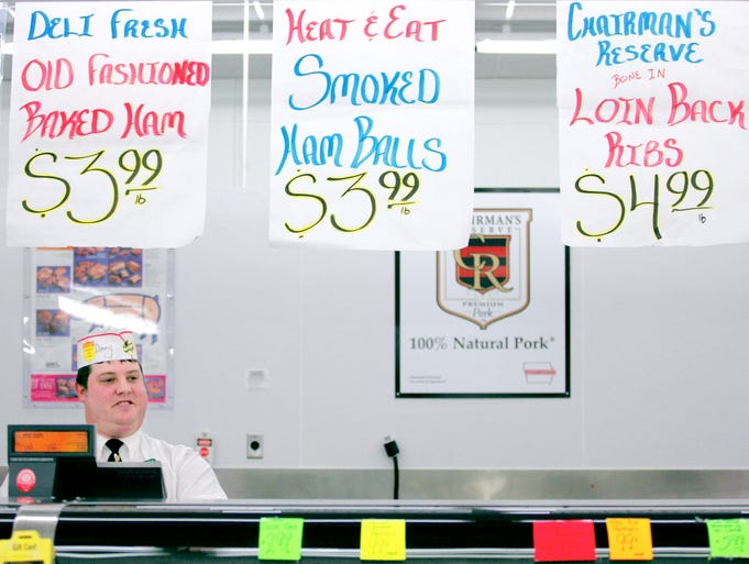 Danny Bruck waits on customers in the meat department at Fareway in Ankeny.
