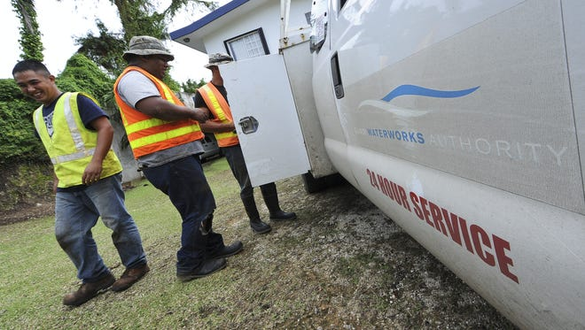 In this 2012 file photo, Guam Waterworks Authority employees stow tools and equipment after fixing a leaking valve in Agana Heights.