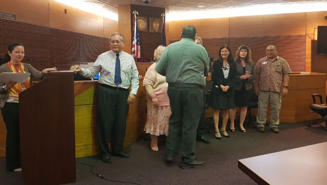 "Department of Corrections Director Alberto ""Tony"" Lamorena V receives a certificate in appreciation for his agency's support of the Superior Court of Guam's Adult Reentry Program during a ceremony on May 4, 2018."