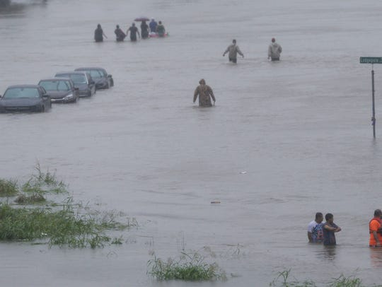 People trapped on South Lake Houston Parkway Monday