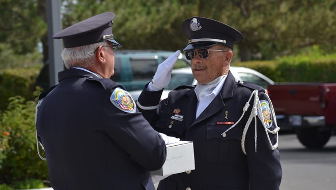 President Brett Palmer of the Northern Nevada Veterans Coalition salutes as he receives the remains of a previously unclaimed veteran during a ceremony at the Northern Nevada Veterans Cemetery on Oct. 1, 2013.