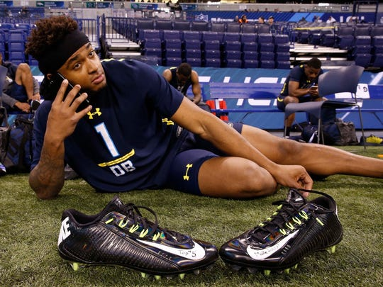 LSU defensive back Jamal Adams rests on the sidelines with writing on his workout shoes of Top #5 and Make History after finishing his workout drills during the 2017 NFL Combine at Lucas Oil Stadium.