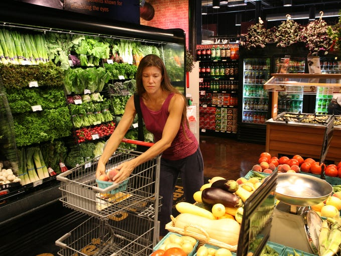 Aubree Taylor shops the produce at the Bistro Market