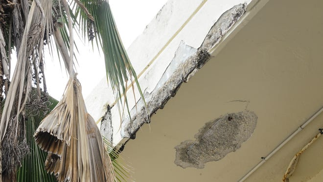 Spalling concrete can be seen on the second-floor overhang in front of the Z-wing of the Guam Memorial Hospital in Tamuning on Tuesday, July 26. Employees working in the affected section, have been moved to other areas of the hospital.