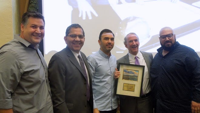 Shown from left are Rudy Valdes; Joe Wardy, CEO of The Hub of Human Innovation; Octavio Gomez; Tripper Goodman, The Hub's board chairman; and Nick Salgado. Valdes, Gomez, and Salgado received the Hub's Innovation Award.