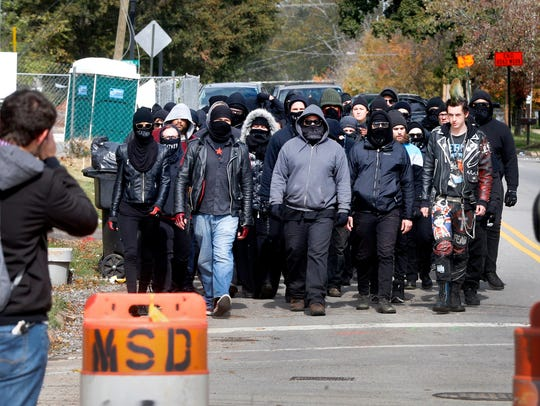 Antifa members march to the White Lives Matter rally