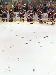 Dead fish eventually replaced the live chicken as a greeting for the Harvard players. Although officially discouraged, the tradition of tossing fish on the ice to welcome the Crimson to Lynah Rink lives on.