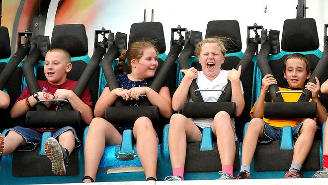 Some visitors seem more excited about the rides than others at the opening night of the Wilson County Fair 