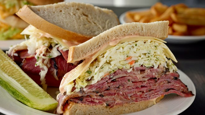 The Stage Deli's West Side Story sandwich is piled high with corned beef.