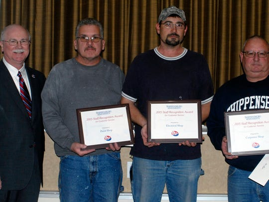 President Jody Harpster and Staff Recognition Award recipients Roy Wiser, Chad Stevenson and Daniel Geyer.