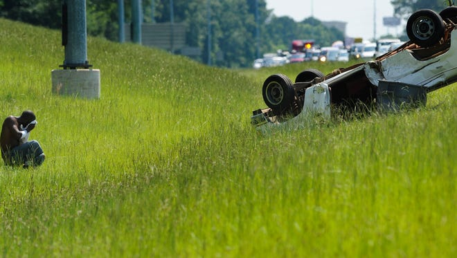 Traffic backs up on I-85 southbound between East Blvd. and Perry Hill Road following a multi vehicle accident that left a pickup truck overturned beside the road on Thursday morning June 18, 2015 in Montgomery, Ala.