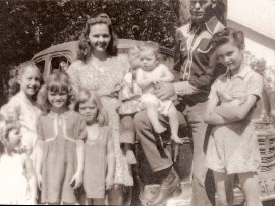 Molly McGhee-McCoy with her children