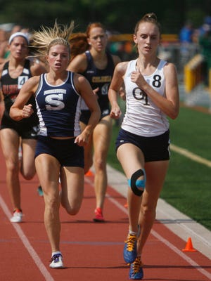 Middletown South's Madison Brand, left, and Northern Valley's Caroline O'Sullivan compete in the Group III 1600m state championships final at Central Regional High School in Bayville, N.J. June 1, 2018.