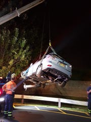 A vehicle is removed from a retension basin following a South Brunswick crash.