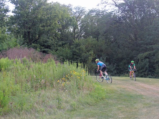 Cyclists try out Coralville's Creekside Cross cyclocross course on Aug. 17, 2017.