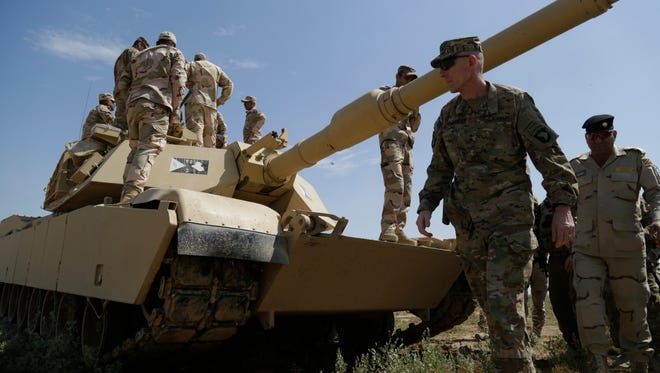U.S. Army Maj. Gen. Gary J. Volesky, commander of the Combined Joint Forces Land Component Command – Operation Inherent Resolve and the 101st Airborne Division, inspects Iraqi soldiers with the 35th Iraqi Army Brigade training on an M1 Abrams tank during his visit to the Besmaya Range Complex, Iraq, April 14, 2016.  (Sgt. Paul Sale)