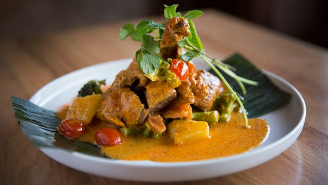 The new Buddha Barn in Sayler Park serves up Roasted boneless Duck Curry.