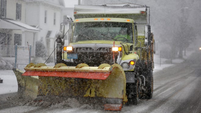 A snow plow reportedly buried two boys under more than six feet of snow.