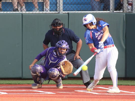 Louisiana Tech's Pauline Tufi reaches down for a pitch Tuesday against No. 4 LSU. The Techsters lost, 30-8.