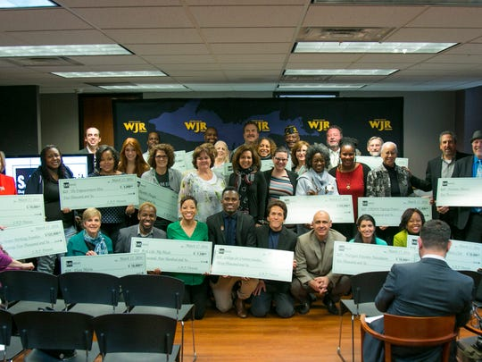 Representatives from 20 area charities accepted checks Thursday in a ceremony at the Fisher Building that totaled over $1 million raised from Mitch Albom's fourth annual S.A.Y. Detroit Radiothon in December.