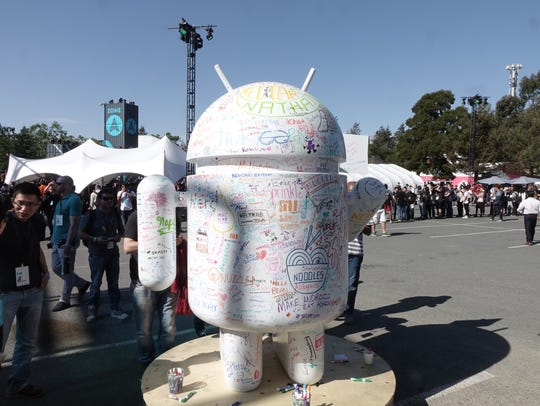 A statue of the Android logo for Google's mobile operating