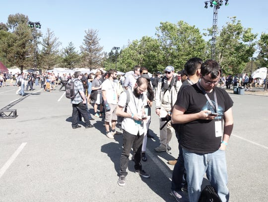 Google I/O attendees wait on line to hear about Project