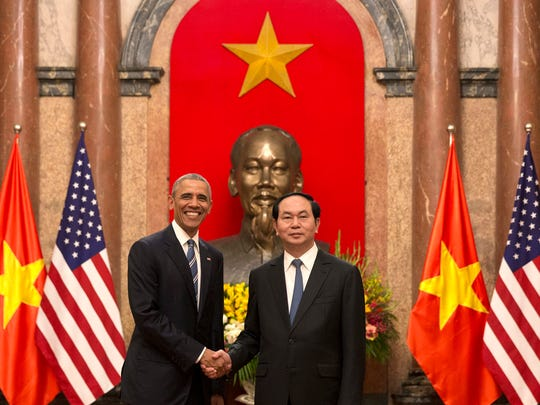 U.S. President Barack Obama (left) and Vietnamese President Tran Dai Quang shake hands at the Presidential Palace in Hanoi, Vietnam, on Monday, May 23, 2016. The president is on a weeklong trip to Asia as part of his effort to pay more attention to the region and boost economic and security cooperation.