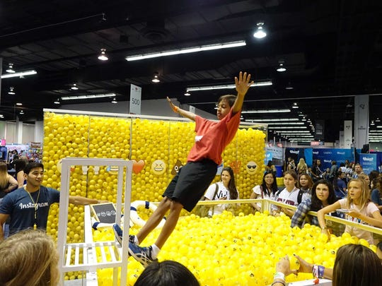 A VidCon attendee falls backwards into a tub of fake