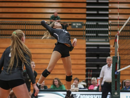 Katie Isenbarger of Zionsville High School goes for the kill.