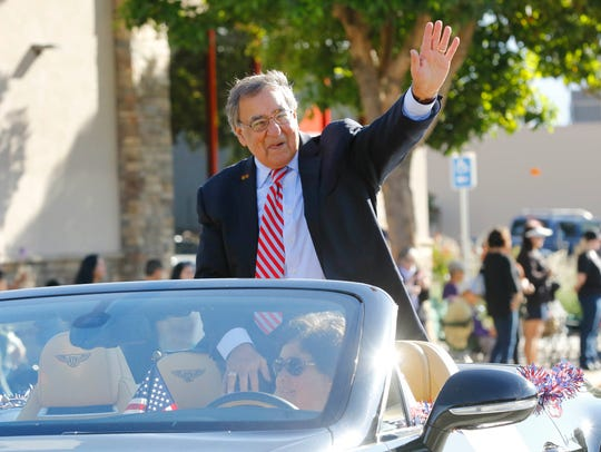 Former Defense Secretary Leon Panetta waves to onlookers as the seventh annual Veterans Day Parade makes its way down South Main Street on Saturday, November 11, 2017 in Salinas Vernon McKnight/for The Californian