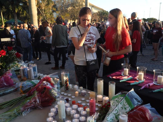 Scenes from the candlelight vigil Thursday, Feb. 15,
