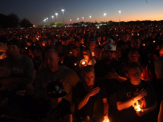 People mourn for the mass shooting victims at Parkland