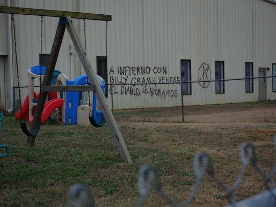Deputies say vandals spray painted derogatory comments,